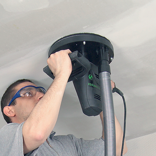 Очистка потолка от побелки шлифмашинкой