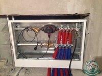 Коллекторный узел отопления в шкафу