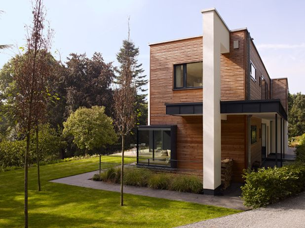 Современный Фасад дома by Bau-Fritz GmbH & Co. KG